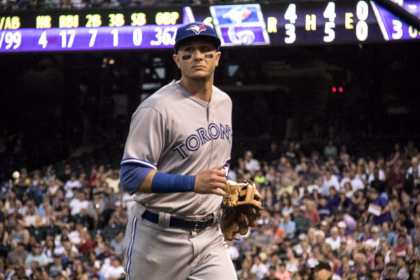 Toronto Blue Jays shortstop Troy Tulowitzki jogs off the field in a game Monday. (Chloe Aiello/Denverite)