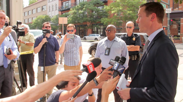 Denver Police Department public information officer Douglas Schepman speaks to the media at 15th an Wynkoop. June 29, 2016. (Kevin J. Beaty/Denverite)crime scene; lodo; union station; shooting; kevinjbeaty; denver; denverite; colorado