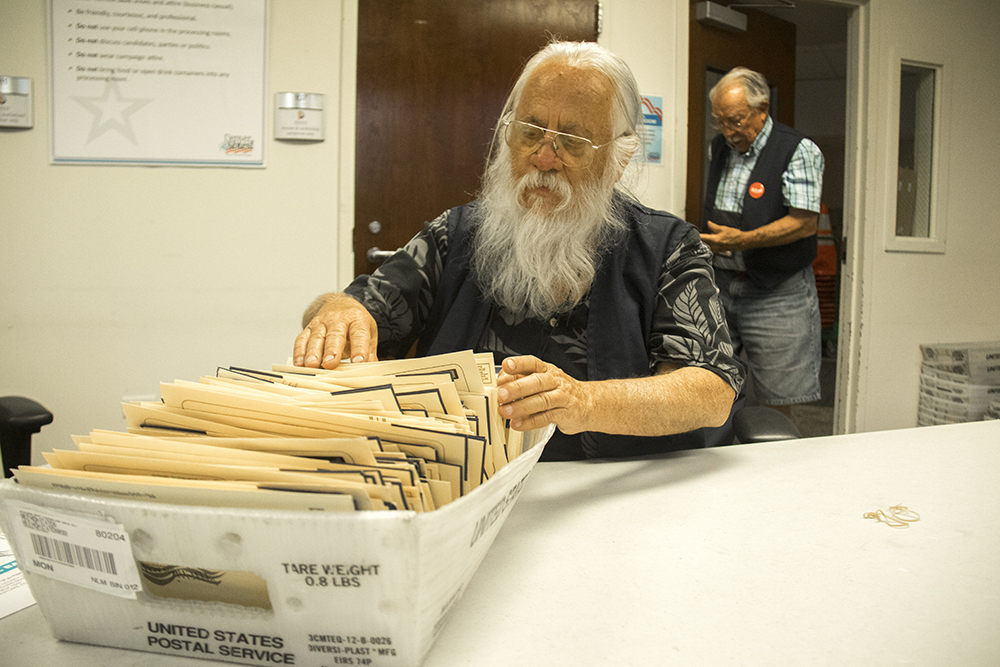 Tom Trujillo (left) and Richard Bettinger have both been working in voting offices for more than a decade. (Kevin J. Beaty/Denverite)  election; ballot; vote; denver; colorado; denverite; kevinjbeaty;