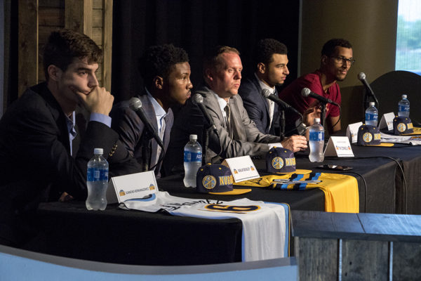 The Denver Nuggets' 2016 NBA draft picks flank general manager Tim Connelly (center): Juancho Hernangomez (left to right), Malik Beasley, Jamal Murray and Petr Cornelie at a press conference on June 29, 2016. (Kevin J. Beaty/Denverite)  denver nuggets; colorado; sports; basketball; draft; press conference; kevinjbeaty; denverite;