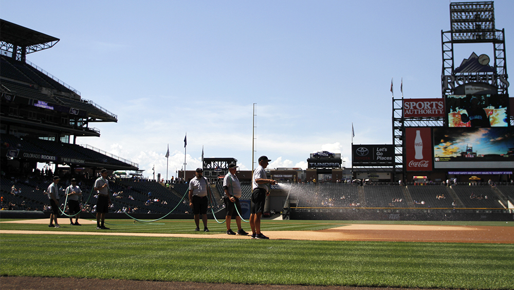 Coors Field staff water down the first base corner during the Colorado Rockies vs. Pittsburgh Pirates game on, June 9, 2016. (Photo by Jessica Taves)  baseball; rockies; jessica taves; coors field; sports; denverite; denver; colorado;