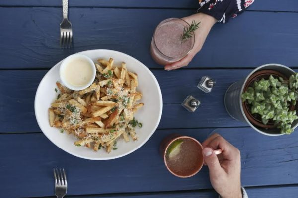 Cocktails and french fries at Eureka! (Provided by Eureka Restaurant Group)