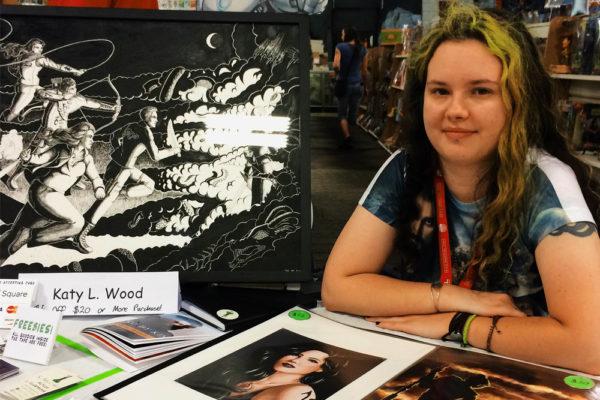 Katy Wood set up shop at at Mile High Comics for the Denver Comic Con 2016 pre-party. (Chloe Aiello/Denverite)
