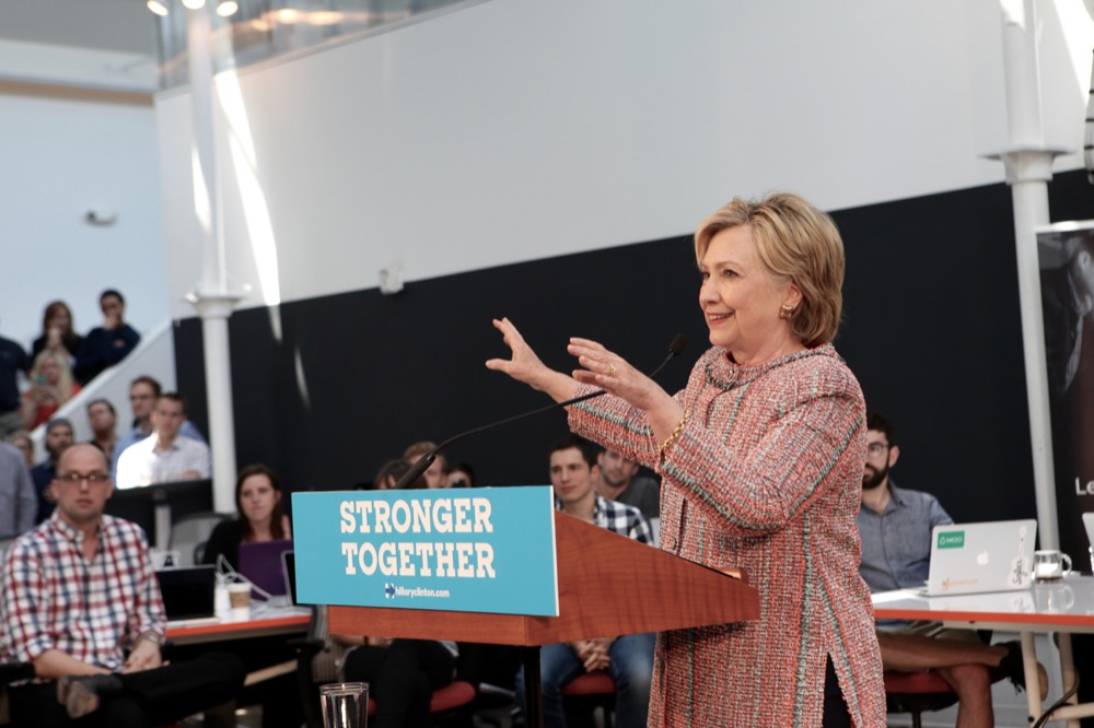 Hillary Clinton addresses a crowd at a Galvanize campus in Denver. (Andrew Kenney / Denverite)