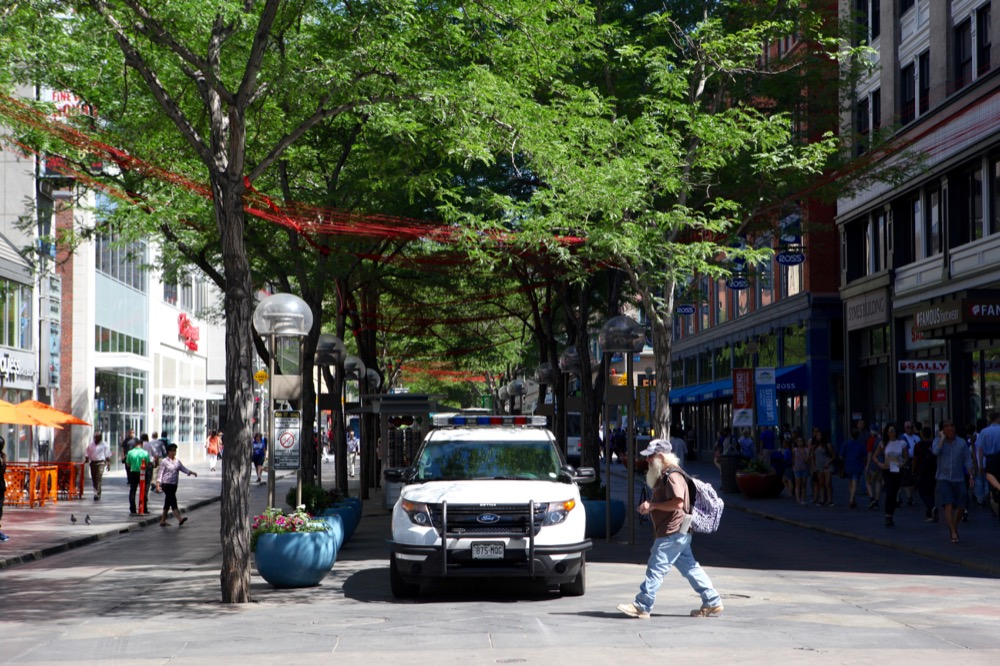 Police vehicles were positioned along the 16th Street Mall during a press conference about safety on Monday, June 27, 2016. (Andrew Kenney / Denverite)