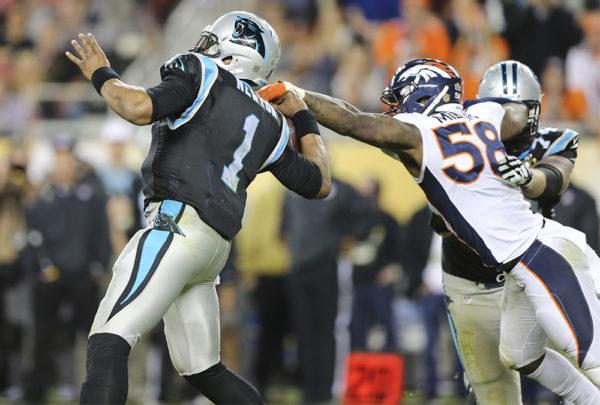 Denver Broncos linebacker Von Miller (58) strip sacks Carolina Panthers quarterback Cam Newton (1) during fourth quarter action in Super Bowl 50 at Levi's Stadium in Santa Clara, CA, February 7, 2016. Photo by Ben Hays.