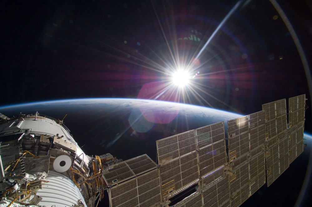 Sun peeking over the International Space Station. (Courtesy of NASA)