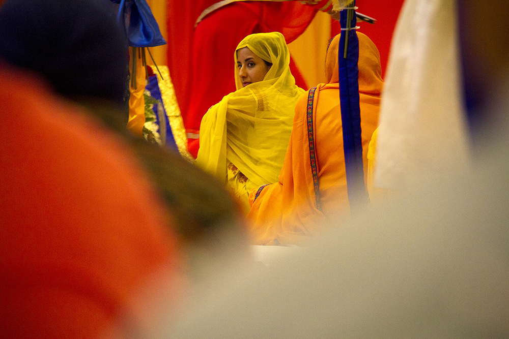 Naureen Singh looks back at the crowd during the Vaisakhi celebration. (Kevin J. Beaty/Denverite)  guru; indian; sikh; faith; holiday; religion; parade; denver; denverite; colorado; kevinjbeaty