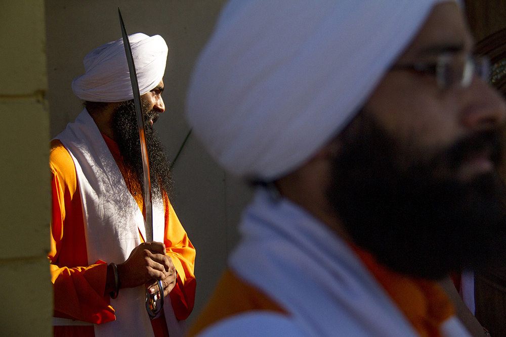"Men ceremoniously dressed as the Panj Pyare, or the ""Five Beloved Ones,"" the first to be baptized as Sikhs. (Kevin J. Beaty/Denverite)  guru; indian; sikh; faith; holiday; religion; parade; denver; denverite; colorado; kevinjbeaty"