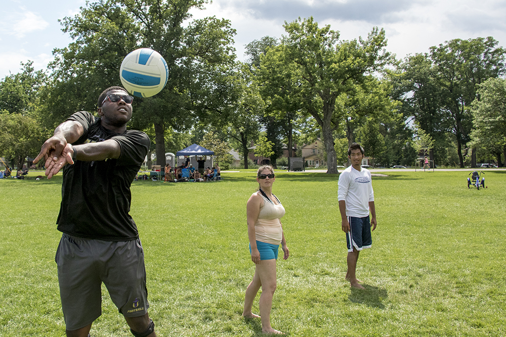 John Jones II bumps a volleyball on the lawn at Washington Park. (Kevin J. Beaty/Denverite)