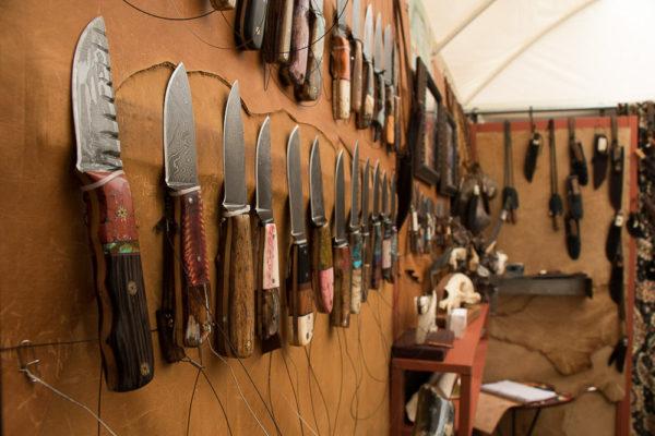 Jake 2 Jake displays pre-made and custom-made knives at the festival. (Chloe Aiello/Denverite)