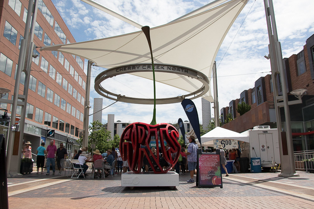 A sculpture by Garret Brown demarcates the main stage of Cherry Creek Arts Festival. (Chloe Aiello / Denverite)