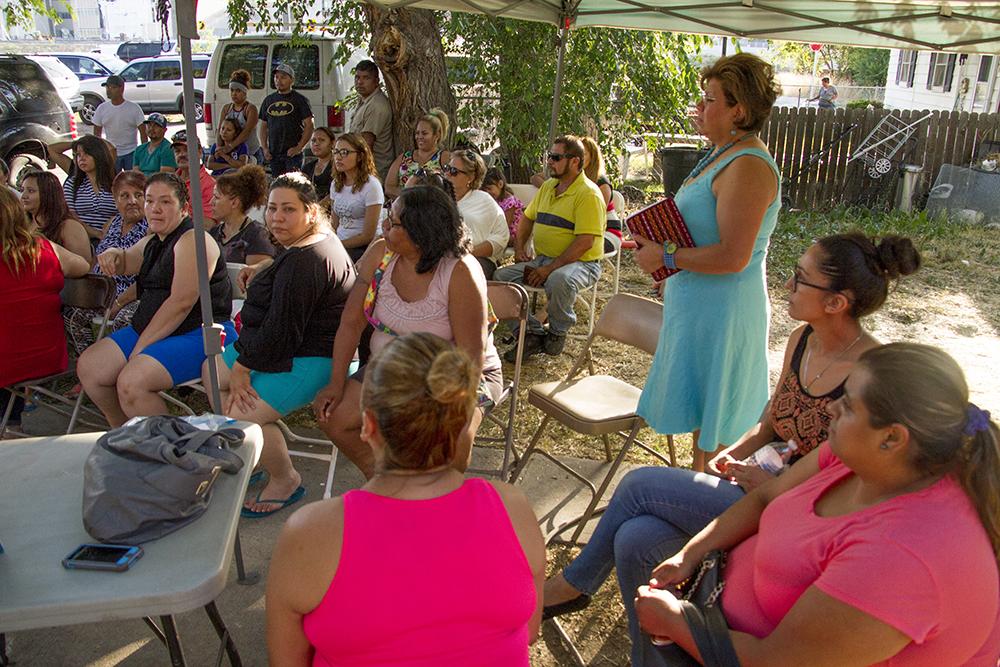 "Denver Meadows mobile home park. residents listen in to a community meeting led by 9 to 5 Colorado organizer Andrea ""Dre"" Chiriboga-Flor. July 6, 2016. (Kevin J. Beaty/Denverite)  denver meadows; affordable housing; trailer park; development; denver; aurora; denverite; kevinjbeaty; colorado;"