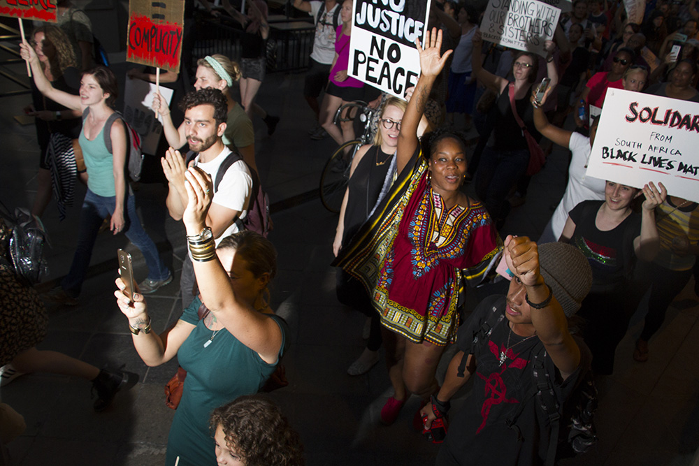 Protesters march down the 16th Street Mall on July 7, 2016. (Kevin J. Beaty/Denverite)  black lives matter 5280; protest; march; denver; colorado; kevinjbeaty; denverite;
