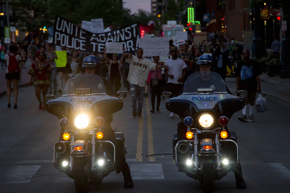 Police motorcycles lead protests in a touch-and-go escort down the 16th Street Mall on July 7, 2016. (Kevin J. Beaty/Denverite)