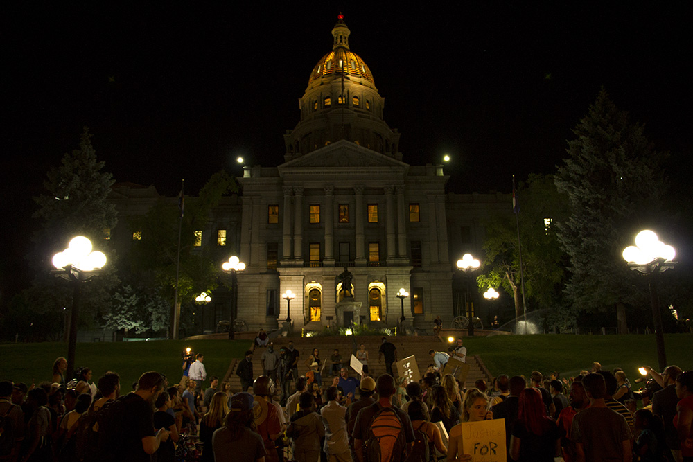 Rallyers chant in the middle of Lincoln in front of the State Capitol on July 7, 2016. (Kevin J. Beaty/Denverite)  black lives matter 5280; protest; march; denver; colorado; kevinjbeaty; denverite;