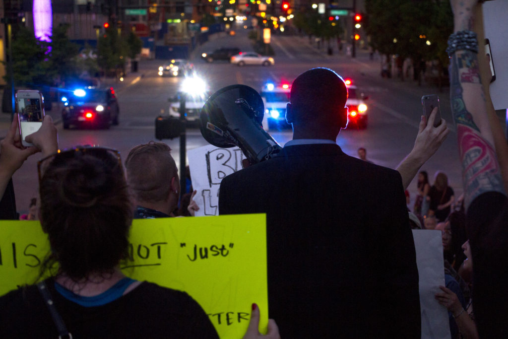 Protesters from Black Lives Matter march through downtown Denver Thursday night. (Kevin J. Beaty/Denverite)