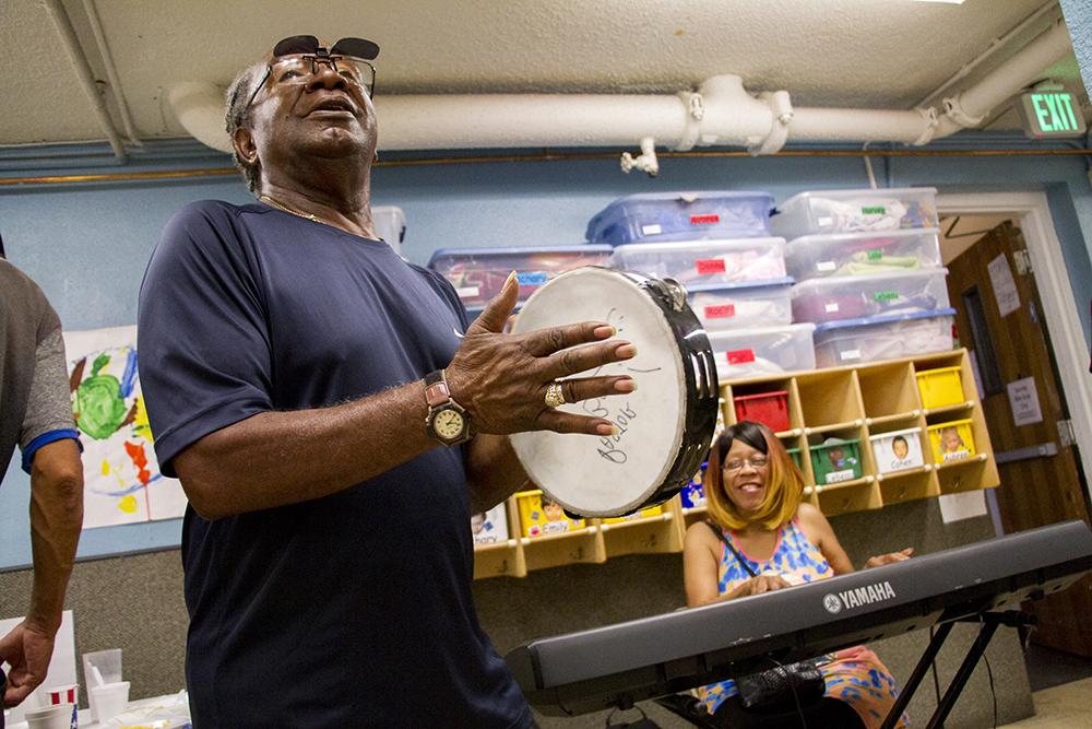 Pastor Bob Johnson and Bobbi Malone play upbeat gospel tunes at one end of the breakfast hall. (Kevin J. Beaty/Denverite)  church; religion; public service; kevinjbeaty; colorado; denverite; denver;