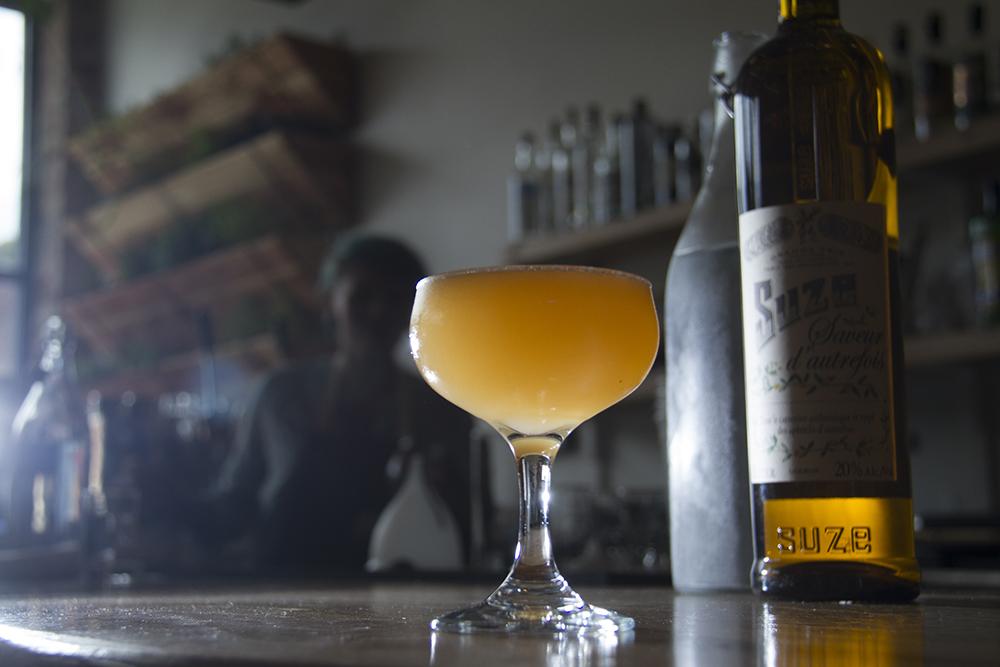 """Suze, Susie, Suzy"" rests on the bar at home at Hudson Hill on 13th Avenue. (Kevin J. Beaty/Denverite)  food; grapefruit cocktail; denver; drinks; nightlife; kevinjbeaty; denverite; colorado;"