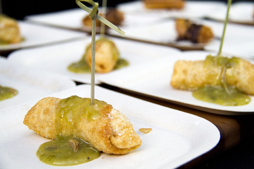 "Mini chile rellenos topped with La Loma's ""famous"" green chili, prepared for the Big Eat at the Denver Center For The Performing Arts, July 14, 2016. (Kevin J. Beaty/Denverite)  food; big eat; Denver Center For The Performing Arts; denver; kevinjbeaty; colorado; denverite;"