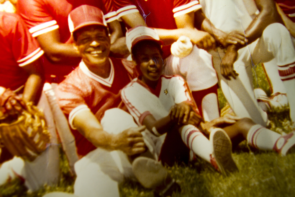A photo of Joe Brooks sitting with Beverly Buckmon's son Tyrone in a photo with the 34th Street Merchants. (Kevin J. Beaty)  baseball; sports; five points; denver randalls; kevinjbeaty; denver; denverite; kevinjbeaty; colorado;