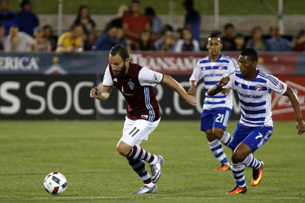 Colorado Rapids Shkelzen Gashi runs past FC Dallas Carlos Gruezo as FC Dallas Michael Barrios watchs during the game at Dick's Sporting Goods Park, July 23, 2016. Rapids took the lead in the first half, and lost the lead when DC Dallas scored in the second half and the game ended in a tie 1-1. (Jessica Taves/For Denverite)  jessica taves; denverite; colorado rapids; fc dallas; sports; soccer; colorado; denver;