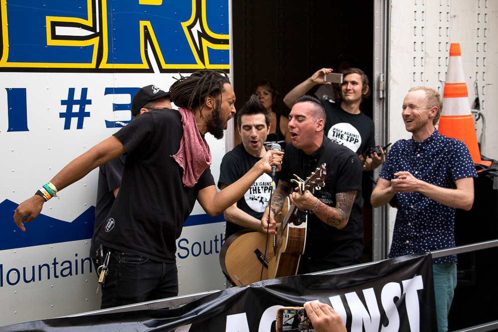 Flobots rap outside of Line waiting outside of Summit Music Hall for Rock Against the TPP (Chloe Aiello/Denverite)