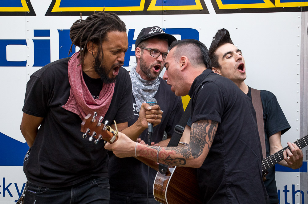 Two members of the Flobots sang with Anti-Flag  during a pre-show rally outside of Summit Music Hall. (Chloe Aiello/Denverite)