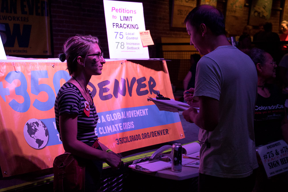 350.org set up booths to oppose fracking at Rock Against the TPP (Chloe Aiello/Denverite)