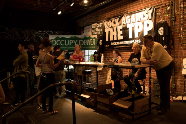 was one of many nonprofits and activist groups that set up a booth inside Summit Music Hall. (Chloe Aiello/Denverite)