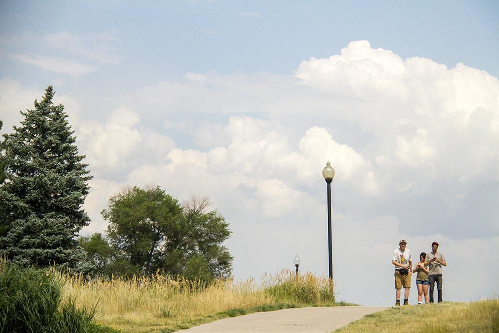 Rollerbladers crest a hill in Lakewood's Belmar Park. (Kevin J. Beaty/Denverite)  belmar park; lakewood; denver; colorado; kevinjbeaty; denverite;