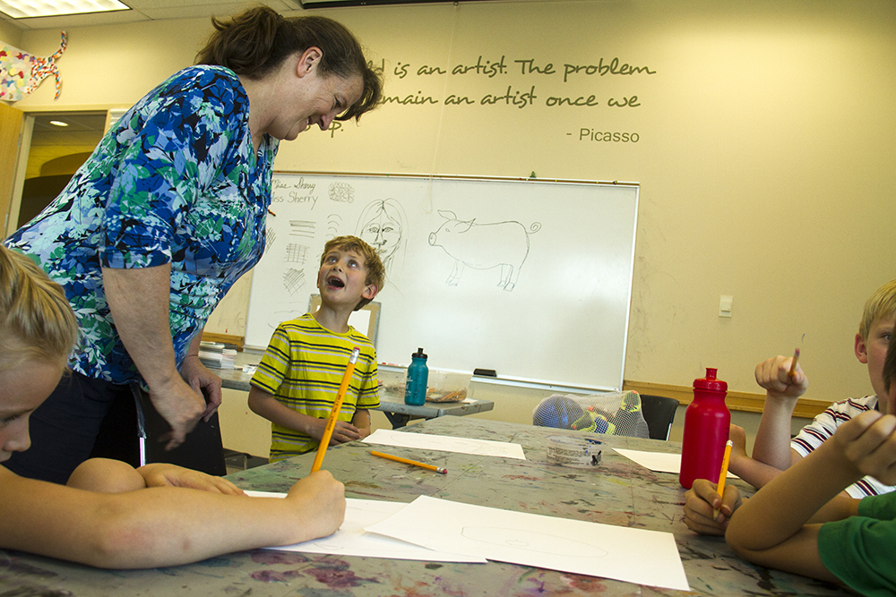 Kids learn to draw in Sherry Hamby's painting and drawing camp at the Lakewood Performing Arts Center. (Kevin J. Beaty/Denverite)  lakewood performing arts center; denver; performance; performing arts; theater; kevinjbeaty; denverite; colorado
