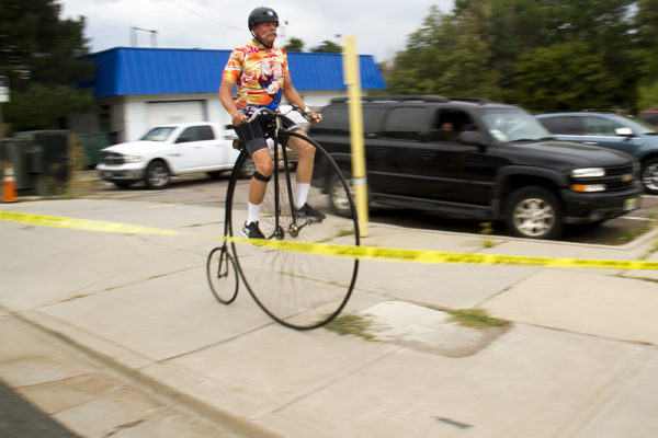 Paul Brekus and his penny-farthing bicycle and vintage moustache. The Bannock Street Criterium. July 31, 2016. (Kevin J. Beaty)