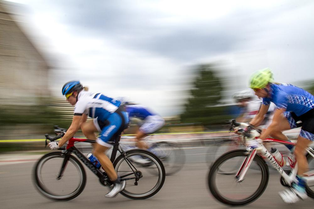 Jennifer Sharp hangs onto the inside of a turn. The Bannock Street Criterium. July 31, 2016. (Kevin J. Beaty)  biking; bike; cycling; golden triangle; bannock street criterium; denver; colorado; sports; kevinjbeaty; denverite;