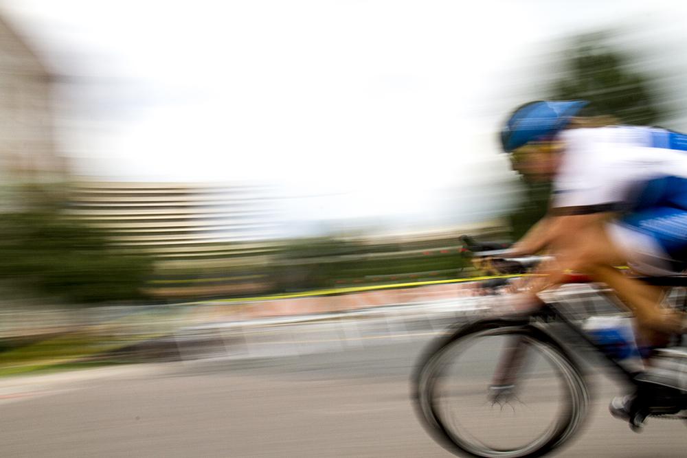 Jennifer Sharp speeds around a corner. The Bannock Street Criterium. July 31, 2016. (Kevin J. Beaty)  biking; bike; cycling; golden triangle; bannock street criterium; denver; colorado; sports; kevinjbeaty; denverite;