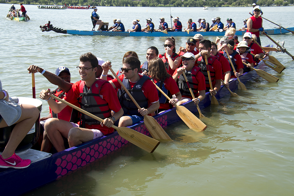 The Water Elephants, made up of Colorado Republican candidates and staff, disembark from the dock at the Colorado Dragon Boat Festival. July 31, 2016. (Kevin J. Beaty/Denverite)  denver; colorado dragon boat festival; race; election; politics; darryl glenn; kevinjbeaty; denverite; colorado; sloan lake;