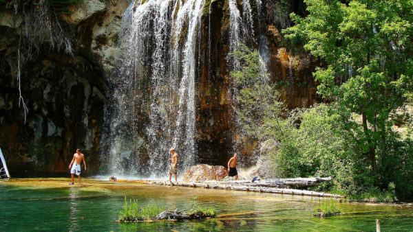 There is algae in the water at hanging lake--probably in part because of swimmers like these. (Zach Dischner/Flickr)