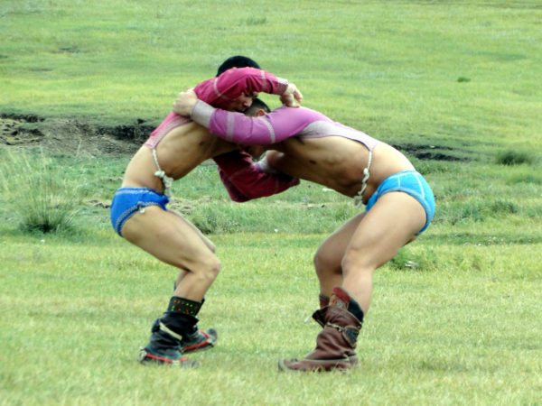 Traditional Mongolian wrestling at a Nadaam festival. (A. Omer Karamollaoglu/Flickr)
