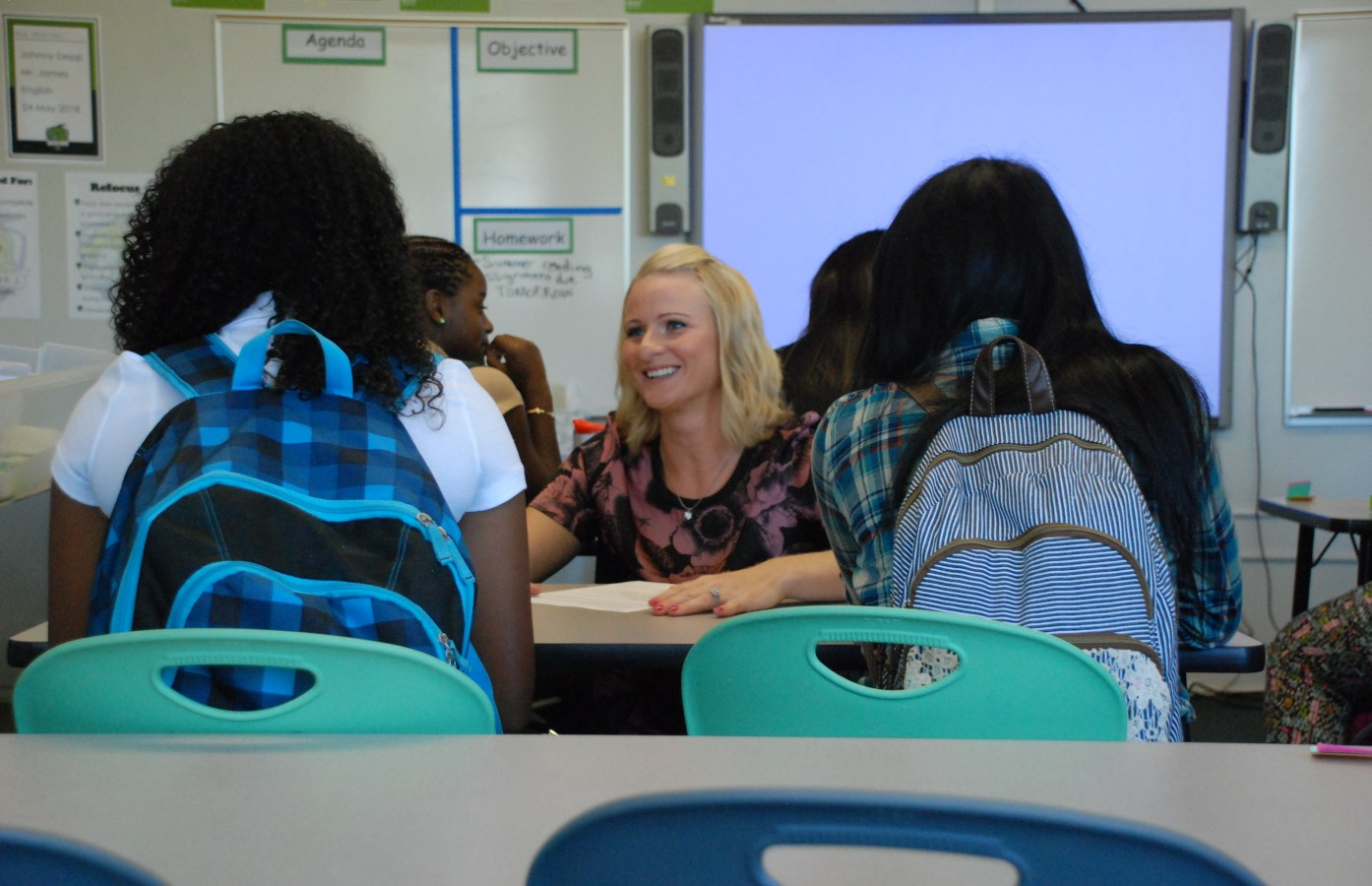 A teacher at DSST Cole High in Denver greets her students on the first day of class. ( Photo by Nicholas Garcia )
