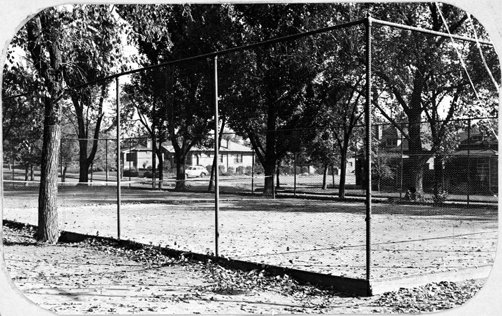 """Tennis court Columbus Park 38th & Osage""  ""View of the tennis court in Columbus Park at 38th (Thirty-eighth) Avenue and Osage Street in Denver, Colorado.""  Between 1930 and 1940. (Denver Public Library/Western History Collection/X-20330)"