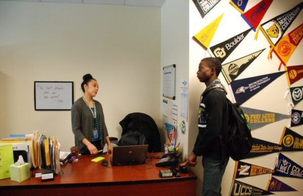 Hinkley College Center director Jazmin Lopez speaks with senior Moise Kombo in January. (Photo by Nicholas Garcia )