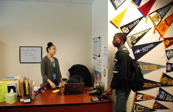 Hinkley College Center director Jazmin Lopez speaks with senior Moise Kombo in January. (Photo by Nicholas Garcia )