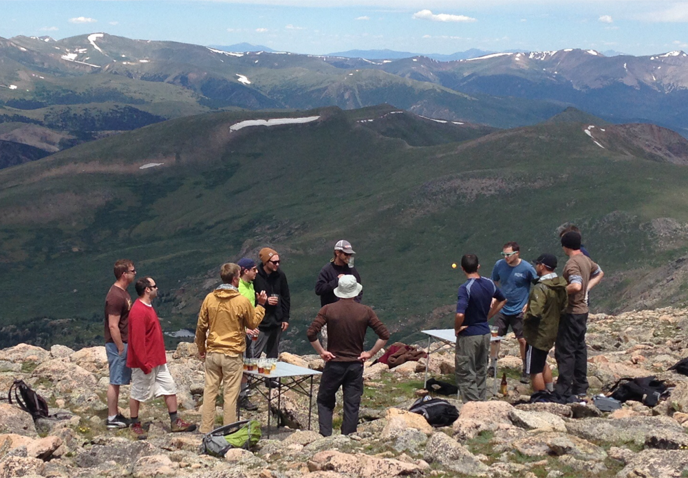 A bunch of dudes play beer pong on Mt. Bierstadt in 2015, just about 14,000 feet above sea level. (Andrew Kenney/Denverite)