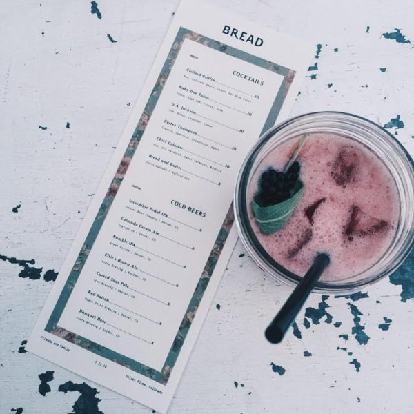 A menu and beverage at the soon-to-reopen Bread Bar. (Photo by Lauren Hendrick)