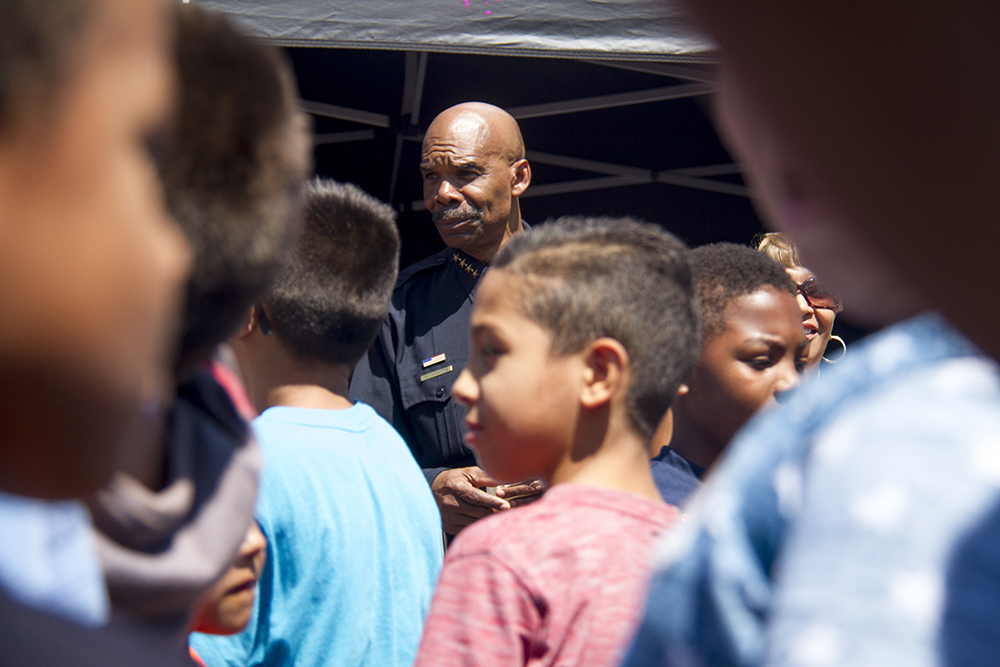 Dance judge and Denver Police Chief White watches as Kids and officers do the Nae Nae during a dance-off at the Cookout with Cops event on Aug. 20, 2016. (Kevin J. Beaty/Denverite)  police; denver; colorado; kevinjbeaty; denverite