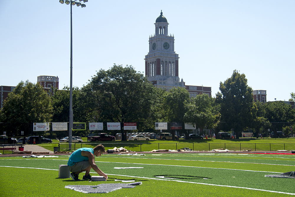New turf gets installed at East High School. (Kevin J. Beaty/Denverite)  east high school; sports; football; kevinjbeaty; denver; denverite; colorado;