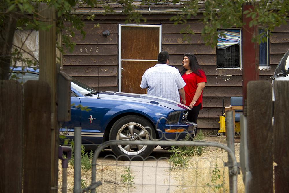 Esmeralda Aguilar outside her home in Elyria Swansea. (Kevin J. Beaty/Denverite)  elyria swansea; i-70; cdot; development; gentrification; denver; denverite; colorado; kevinjbeaty;
