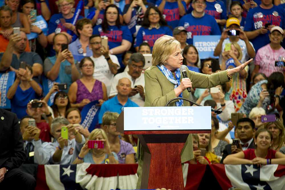 John Hickenlooper and Hillary Clinton at a rally in Commerce City. August 3, 2016. (Kevin J. Beaty/Denverite)  john hickenlooper; hillary clinton; politics; election; vote; kevinjbeaty; denver; denverite; commerce city; colorado;