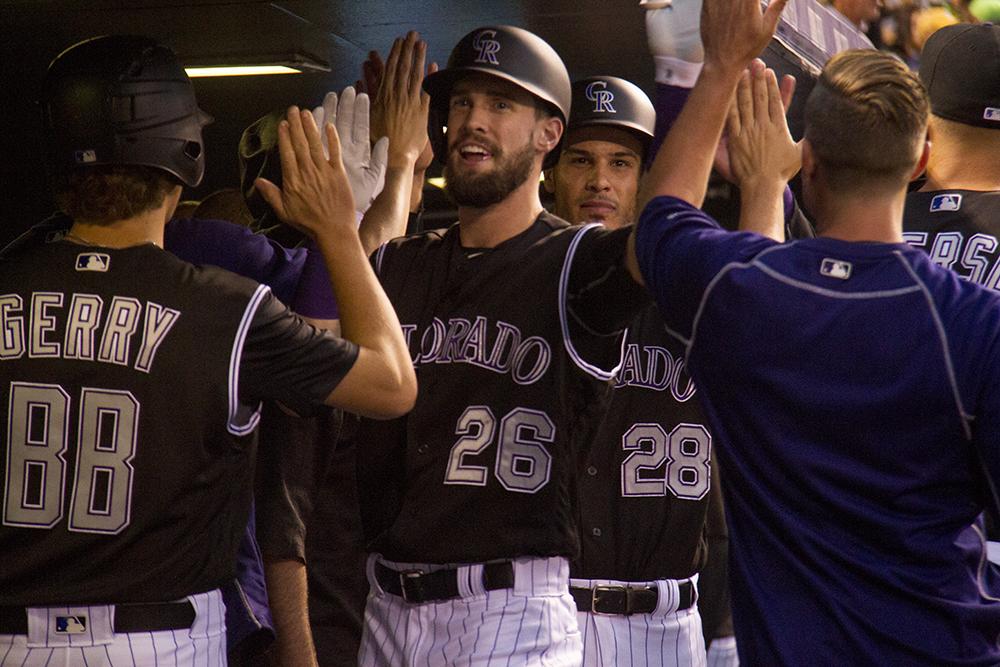 David Dahl high fives teammates after a home run hit. Colorado Rockies vs L.A. Dodgers. August 4, 2016. (Kevin J. Beaty/Denverite)  colorado rockies; los angeles dodgers; baseball; sports; kevinjbeaty; coors field; denver; denverite; colorado;
