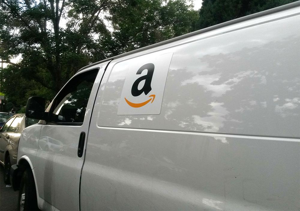 An Amazon Flex van parked in City Park West. (Kevin J. Beaty/Denverite)  amazon flex; delivery; kevinjbeaty; denverite; denver; colorado;